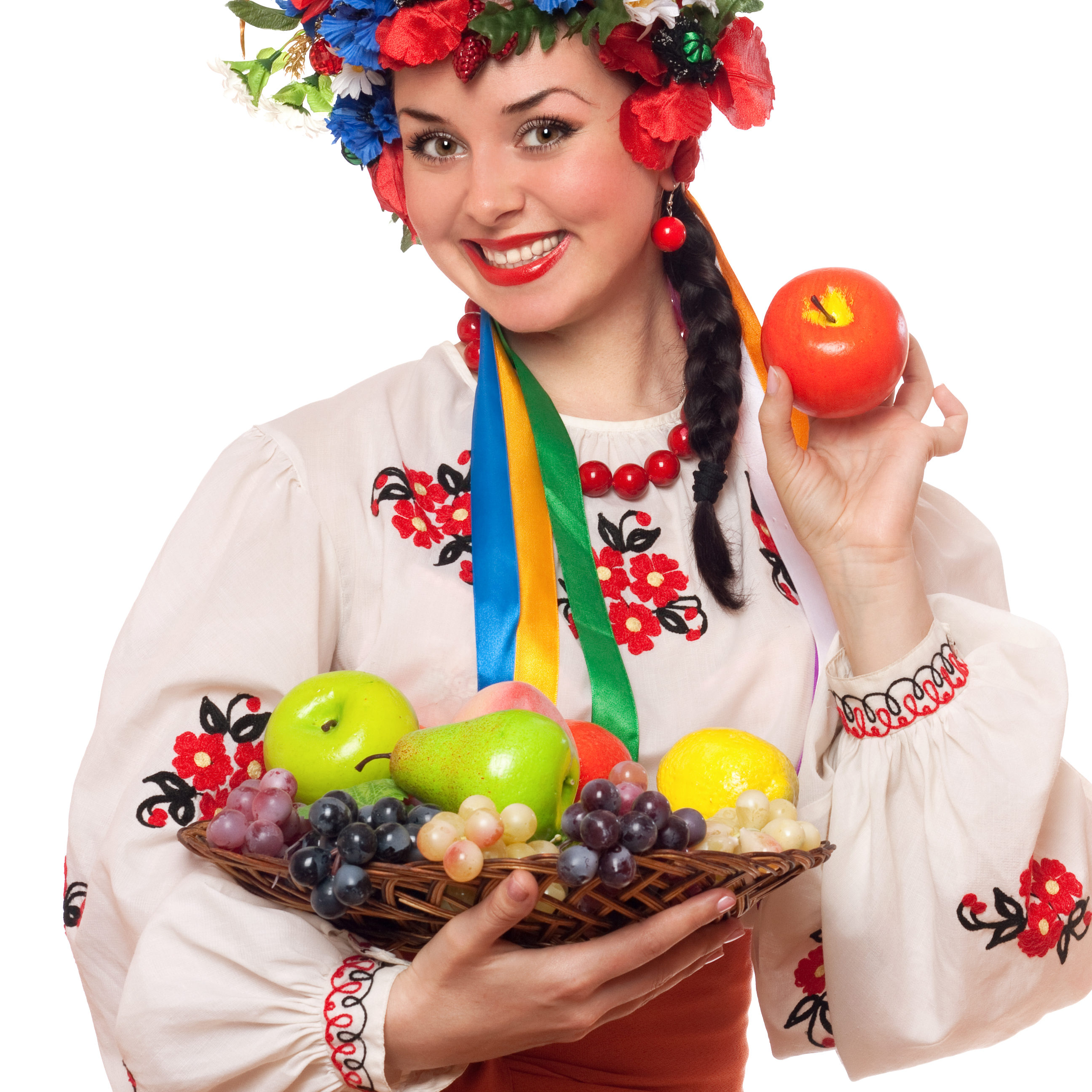 Happy young woman in the Ukrainian national clothes with fruit